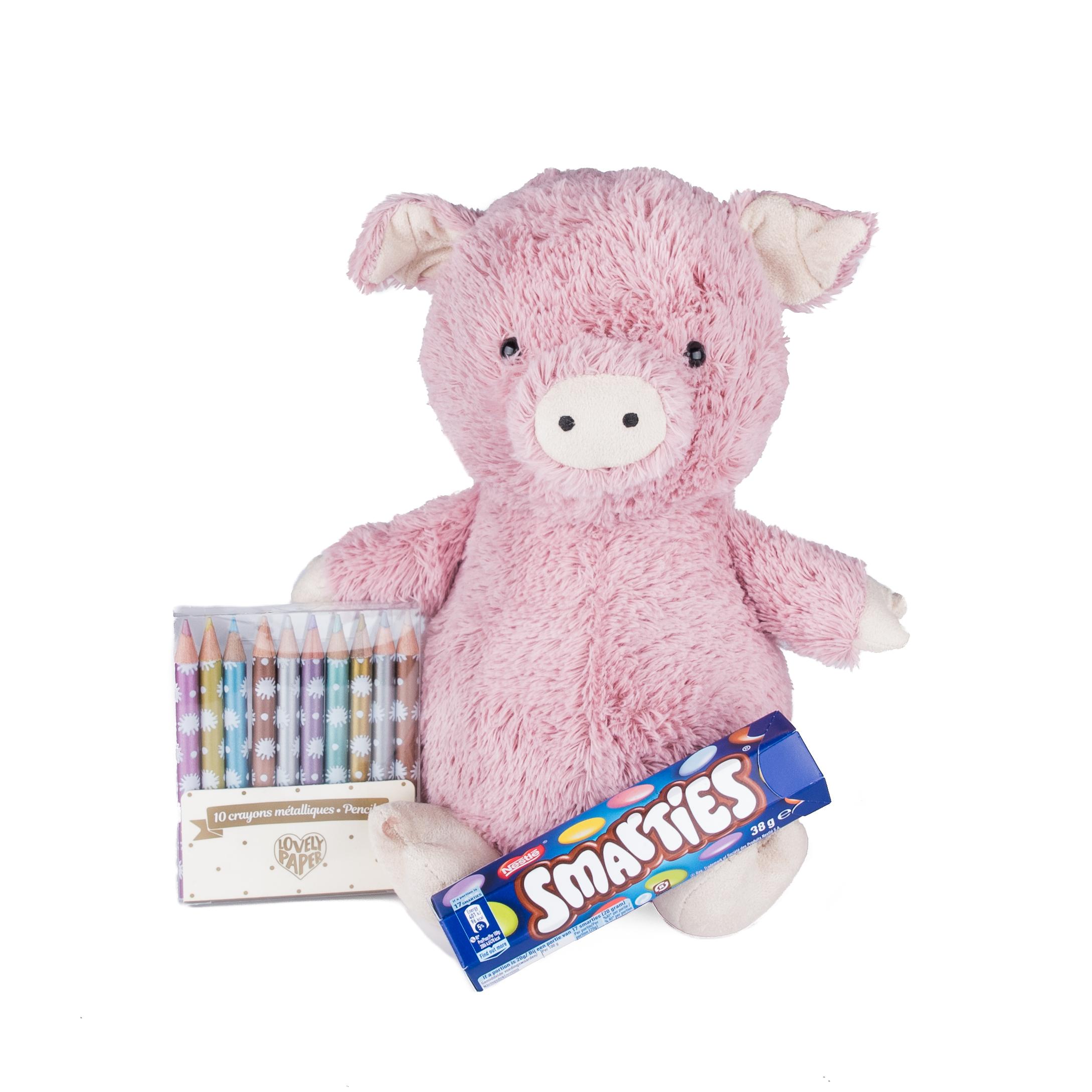Rosa gris med smarties och metallicfärgade pennor